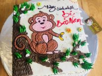 Bánh kem vẽ hình khỉ con trên cành cây